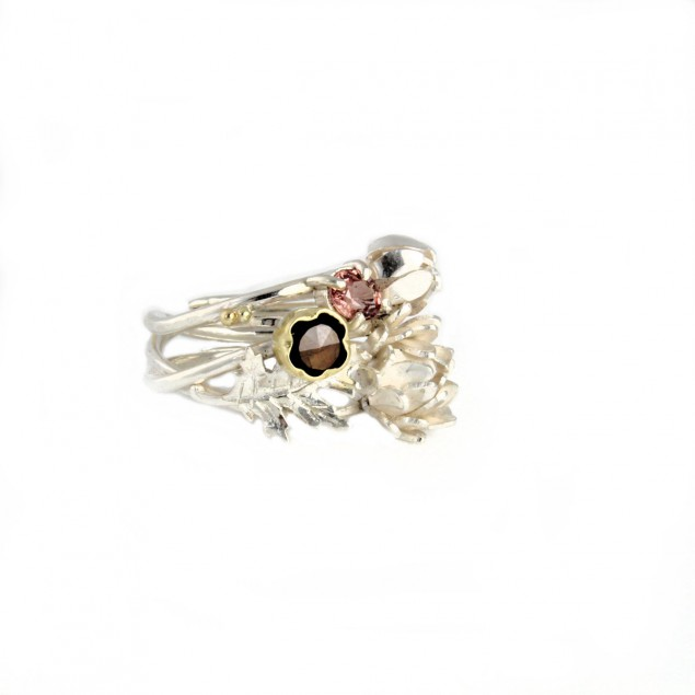 Silver ring with a bouquet of flowers and gemstones