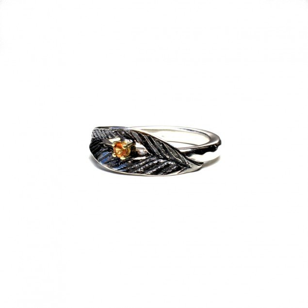 Ring with leaf and orange gemstone