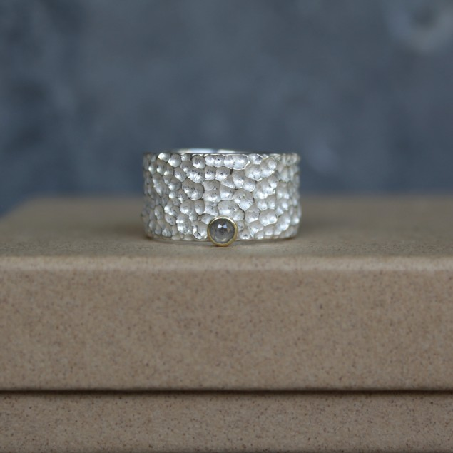 Wide silver ring with diamond